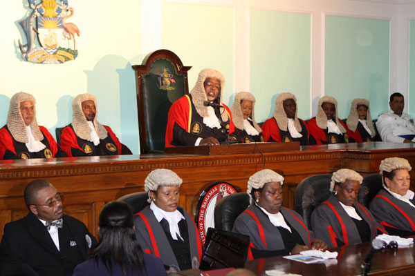 Why did in the past judges wear a black robe and a wig??