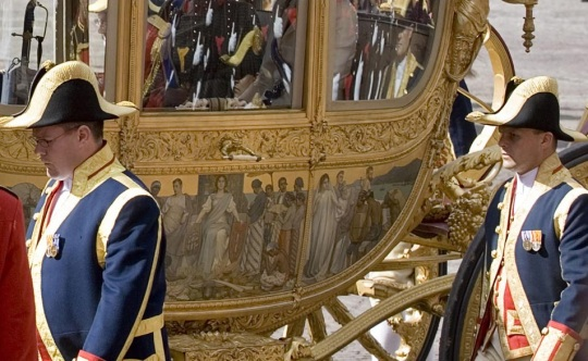 Queen Beatrix in Carriage depicting enslaved Africans