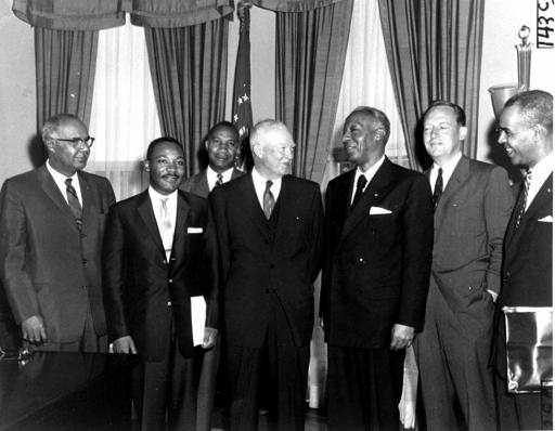 President Dwight D. Eisenhower signing the Civil Rights Act of 1957