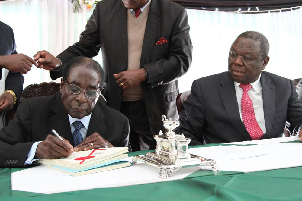 President Robert Mugabe signed the new Zimbabwe constitution into law