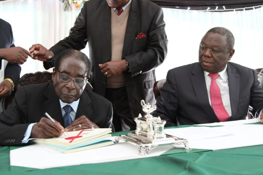 Mugabe Signs Zimbabwe Constitution Into Law