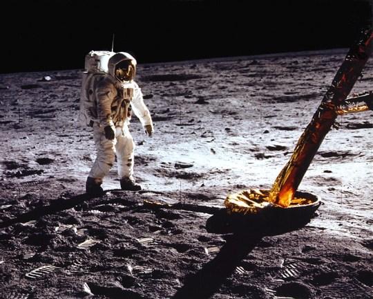 Aldrin stands beside Lunar Module strut and probe
