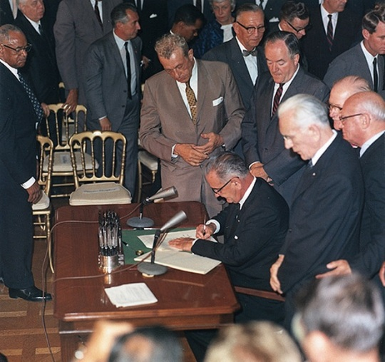 President Lyndon B Johnson signs Civil Rights Act of 1964