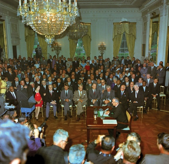 President Lyndon B Johnson signs Civil Rights Act of 1964a